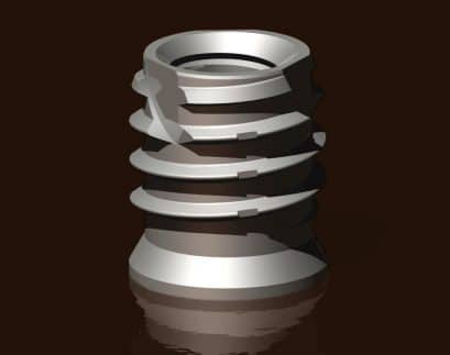 A titanium threaded insert, the Trisert-3, manufactured by Tappex